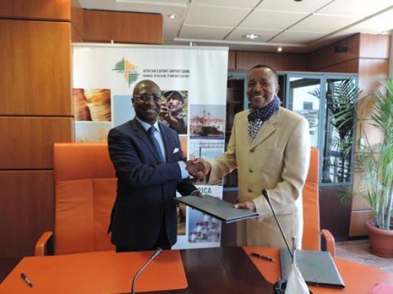 Jean-Louis Ekra, Afreximbank (gauche), et  Dr. Paul Fokam, Président du Groupe Afriland First Bank